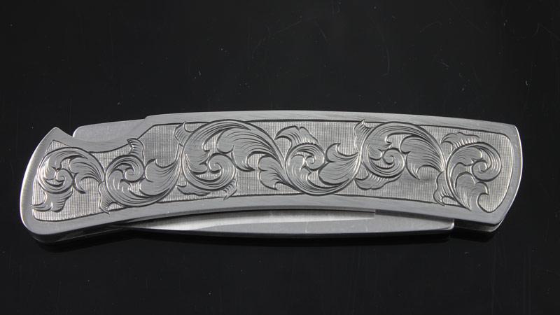 buck gent folding knife    hand engraved