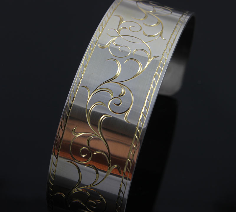 Hand Engraved Silver Bracelet with Running Leaf Border