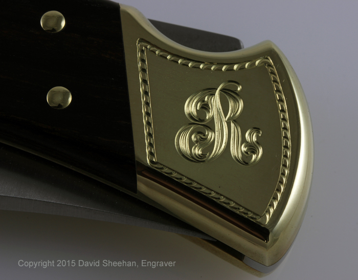 Hand Engraved Buck 110 Folder